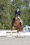 Juan Matute, Jr., 15, and Gasper, earn the second place ribbon in the Prix St. Georges