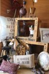 Dog pillows, frames, signs, and other ideas are available for dog lovers at The Tackeria.